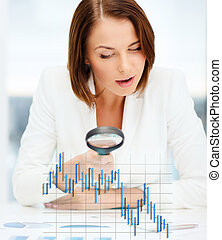 businesswoman working with graphs in office - business,...