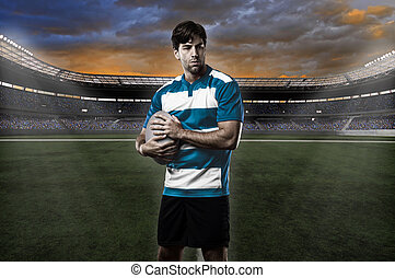 Rugby player in a blue uniform on a stadium