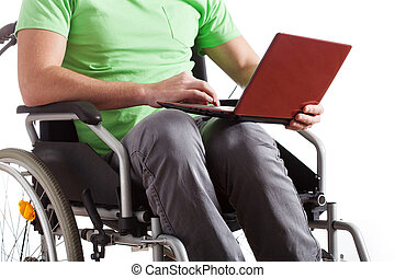 Handicapped with laptop - A handicapped man on a wheelchair...