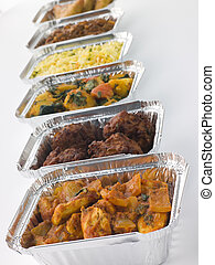 Selection Of Indian Take Away Dishes In Foil Containers