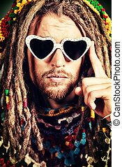hippie love - Portrait of a hippie young man in spectacles.