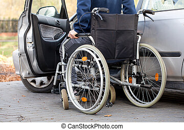 Car driver on wheelchair - A disabled driver using a...