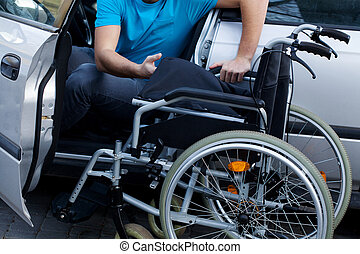 Disabled driver consisting his wheelchair - Handicapped...
