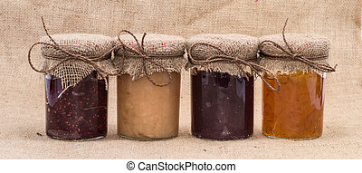 Fresh made Jam in jars on rustic background