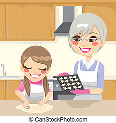 Making Cookies Together - Little girl and grandmother making...