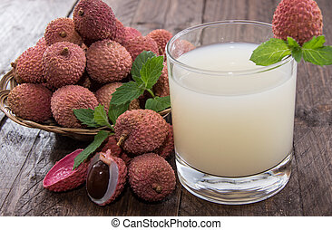 Fresh made Lychee Juice on wooden background