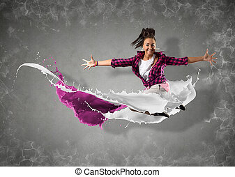 female dancer with splashes of paint - female dancer jumped...