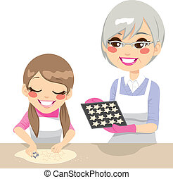 Girl and Grandmother Making Cookies - Little girl and...