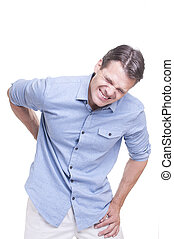 Back pain - Handsome young Caucasian man in blue shirt...