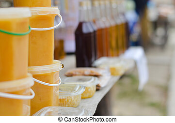 Honey market with various jars and bottles