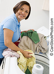 Woman Loading Washing Machine