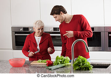 Grandma and grandson cooking - Happy grandma is preparing...