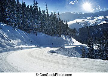 Snowy Mountain Road in Colorado, United States. Winter in...