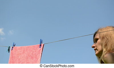 washed clothes hang - attractive young woman hanging washed...
