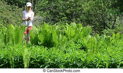 woman water fern plant - young woman girl with white cap...