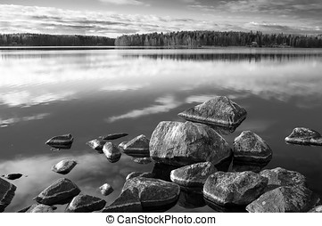 Rocky Shore - Rocks in the water at the shore of the lake in...