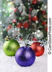 Colorful Christmas baubles on festive background