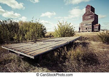 Old Hay Trailer - An old wooden hay trailer by an old grain...
