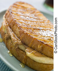 Peanut Butter And Banana Eggy Bread Sandwich With Syrup