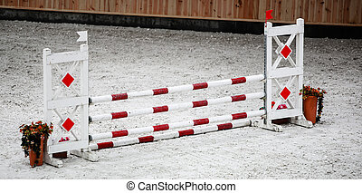 Red white obstacle for jumping horses Riding competition -...