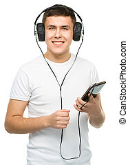 Young man enjoying music using headphones - Closeup portrait...
