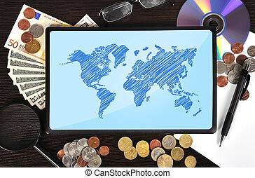 Modern business workplace: tablet with world map