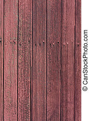 weathered wood with red paint from an old rail car wall