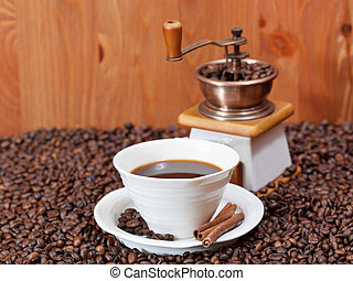 cup of coffee and roasted beans - cup of coffee and roasted...