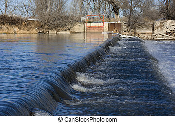 diversion dam on a river - a dam on South Platte River in...