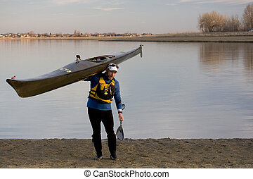 after paddling workout - Middle age male paddler in a life...