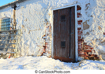 barn door in sunlight a winters day