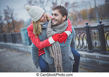 Embracing boyfriend - Image of affectionate girl on her...