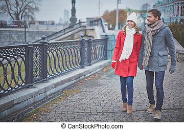 Walking in the city - Portrait of affectionate couple taking...
