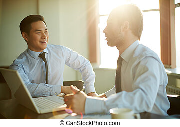 Explaining idea - Portrait of smart businessmen discussing...