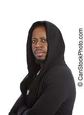 Male African immigrant wearing a black hooded top looking at...