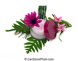 Cosmetic pink cream with herbs and flowers on white...