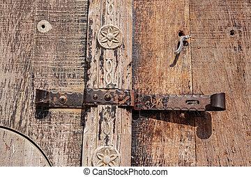 old deadbolt on wooden door
