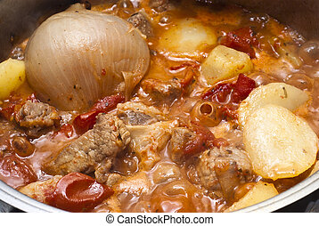 beef stew in the pot - beef stew, potatoes and onion in the...