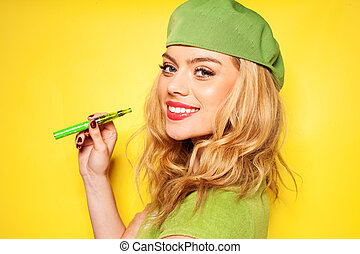 Trendy woman in green with an e-cigarette - Trendy beautiful...