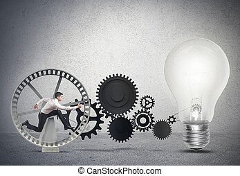 Businessman powering an idea with gear system