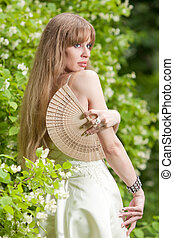woman with a fan - beautiful long-haired young woman with a...