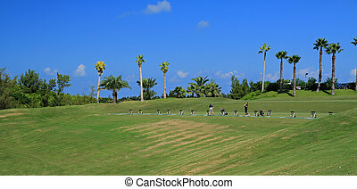 Bermuda golf driving range - A driving range on a sun...