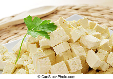 tofu - diced tofu in a plate, on a worktop