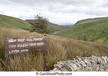 keep our forest tidy sign on mountain road in county Donegal...