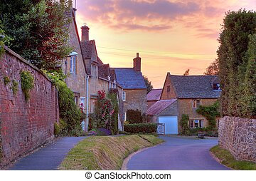 Cotswold cottages at sunset - Cotswold cottages with...