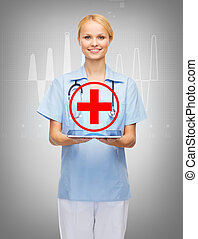 smiling female doctor or nurse with tablet pc - healthcare,...