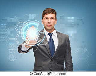 attractive businessman working with virtual screen -...