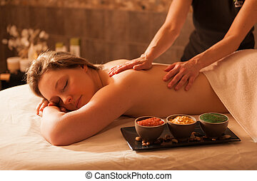 Beautiful woman receiving a massage in a spa - Beautiful...