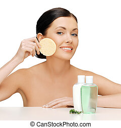 woman with sponge - picture of woman with sponge and...