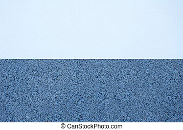 Wall plaster texture in two different tones of blue color and pattern